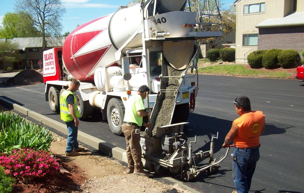 Concrete truck and curb extruder.
