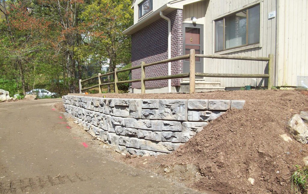 Retaining wall and fence constructed.